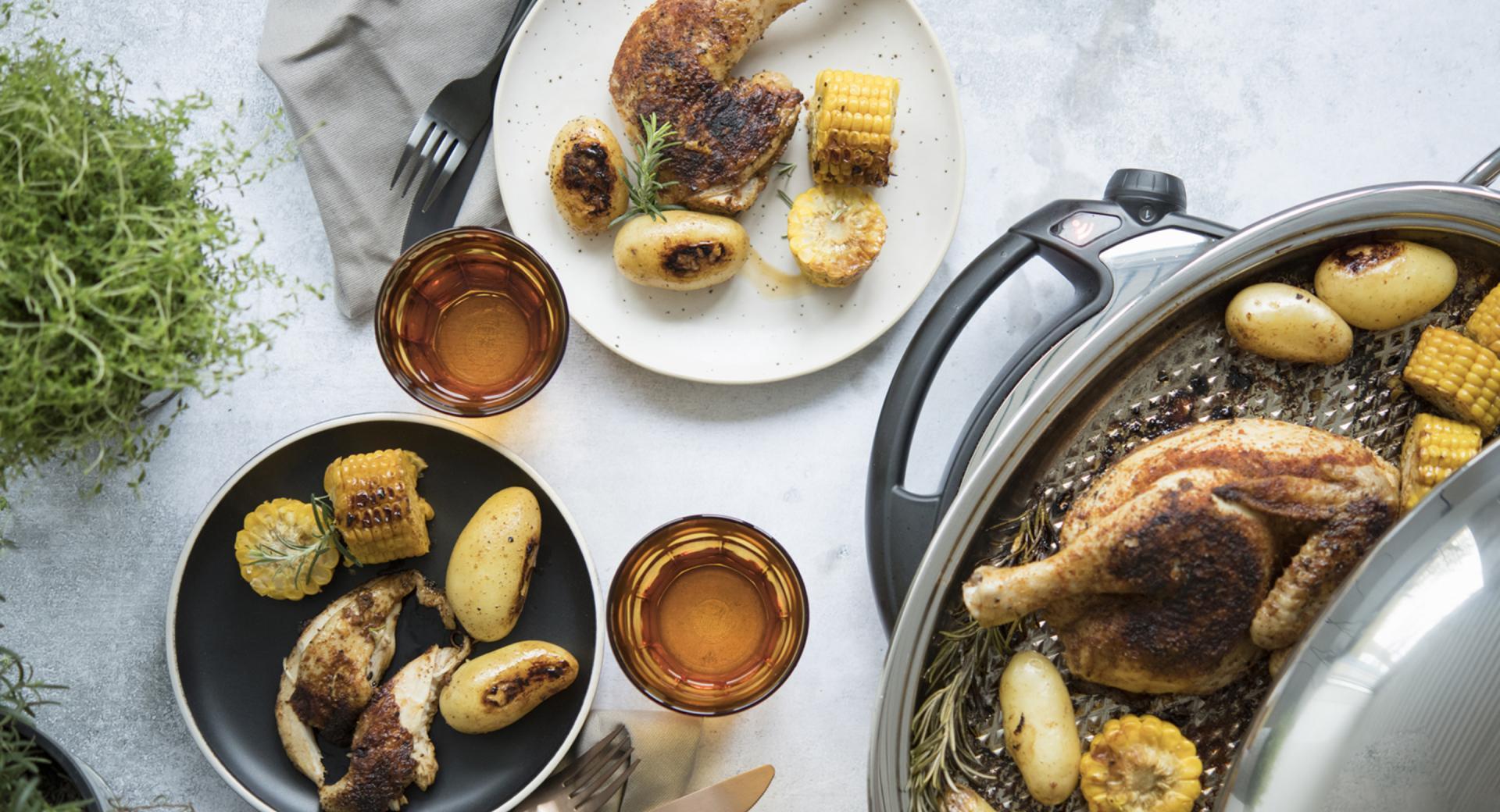 Pollo asado con patatas y maíz