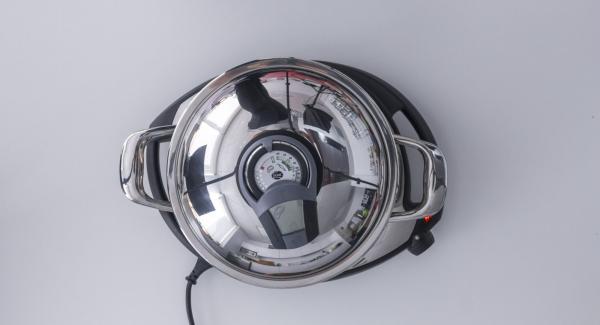 """Colocar la Unidad Sabor 24 cm en el fuego a temperatura máxima. Encender el Avisador (Audiotherm), colocarlo en el pomo (Visiotherm) y girar hasta que se muestre el símbolo de """"chuleta""""."""