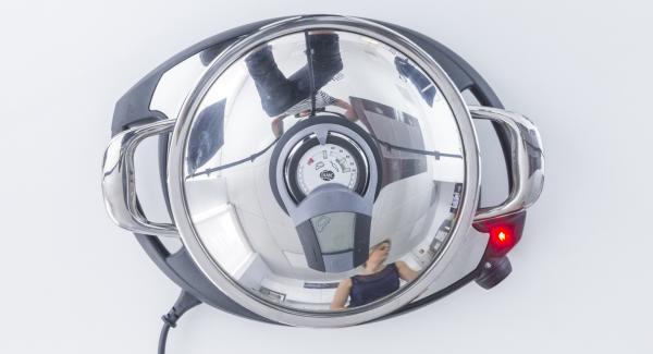 """Colocar la olla de 24 cm en el Navigenio a temperatura máxima (nivel 6). Encender el Avisador (Audiotherm), colocarlo en el pomo (Visiotherm) y girar hasta que se muestre el símbolo de """"chuleta""""."""