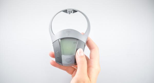 """Encender el Avisador (Audiotherm), colocarlo en el pomo (Visiotherm) y girar hasta que se muestre el símbolo de """"chuleta""""."""