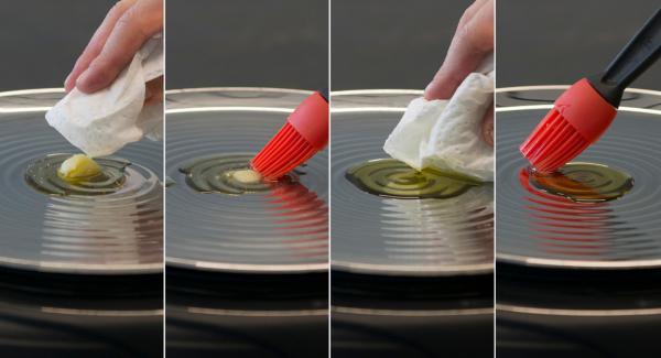 A continuación, bajar la temperatura del Navigenio a nivel 2, añadir el aceite o mantenquilla y esparcirla de forma uniforme por la oPan.