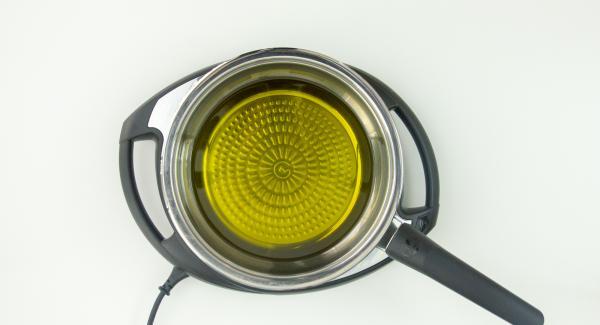 """Colocar la sartén con abundante aceite en el Navigenio a temperatura máxima (nivel 6). Encender el Avisador (Audiotherm), colocarlo en el pomo (Visiotherm) y girar hasta que se muestre el símbolo de """"chuleta""""."""