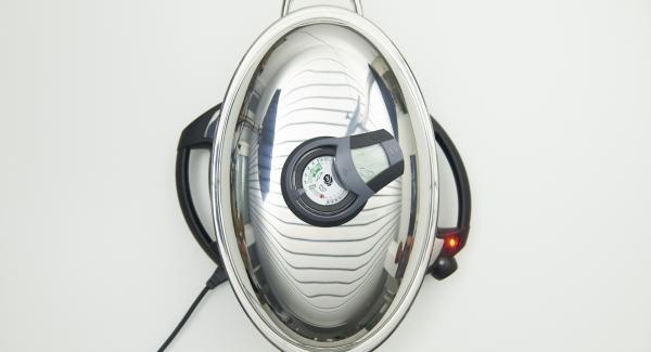 """Colocar la Oval en el Navigenio a temperatura máxima (nivel 6). Encender el Avisador, colocarlo en el pomo (Visiotherm) y girar hasta que se muestre el símbolo de """"chuleta""""."""