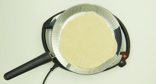 Bajar temperatura nivel 2 y poner una quesadilla en la oPan XL.