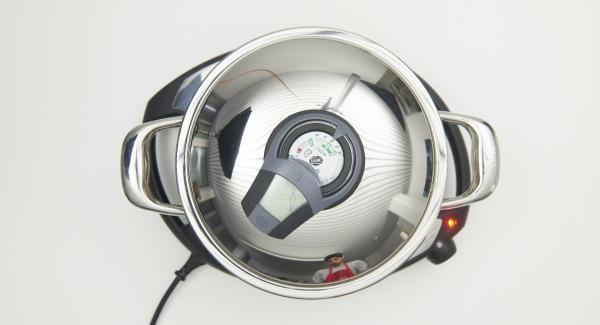 """Encender el Avisador (Audiotherm), colocarlo en el pomo (Visiotherm) y girar hasta que se muestre el símbolo de """"zanahoria""""."""