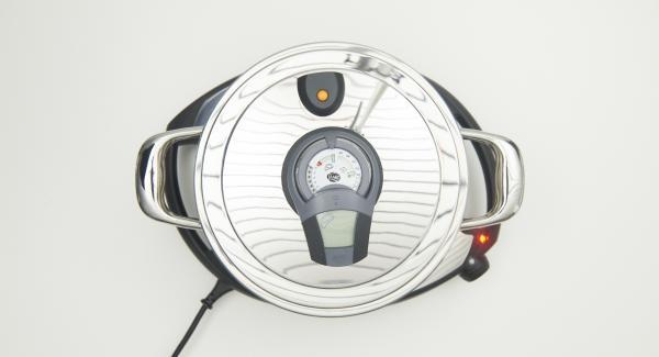 """Colocar la olla con la Tapa Súper Vapor en el Navigenio a temperatura máxima nivel 6. Encender el Avisador (Audiotherm), colocarlo en el pomo (Visiotherm) y girar hasta que se muestre el símbolo de """"chuleta""""."""