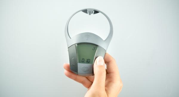 Colocar la olla en el Navigenio y seleccionar la función (A). Encender el Audiotherm Plus, introducir aprox. 10 minutos de tiempo de cocción, colocar en el pomo y girar hasta que aparezca el símbolo 60°C.