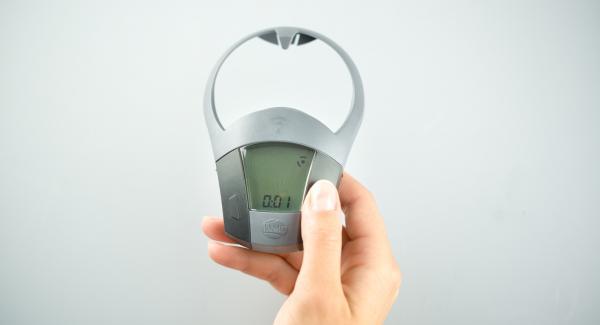 """Tapar con la Tapa Rápida (Secuquick Softline). Colocar una olla en el Navigenio y seleccionar la función """"A"""", encender el Avisador (Audiotherm), introducir 1 minutos de tiempo de cocción. Colocarlo en el pomo (Visiotherm) y girar hasta que aparezca el símbolo """"Soft""""."""