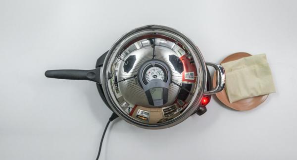 """Colocar la sartén en el fuego a máxima temperatura. Encender el Avisador (Audiotherm), colocarlo en el pomo (Visiotherm) y girar hasta que aparezca el símbolo de """"chuleta""""."""